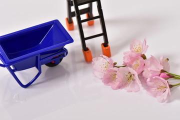 桜と工事のイメージ