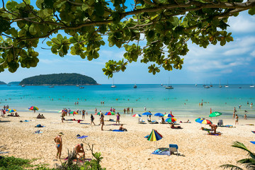 Tourists on the Nai Harn beach - one of the best beaches in Phuket