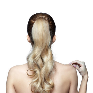 Blonde woman from back side with long hair in ponytail