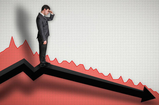 Businessman standing on a graph and looking down on the results