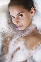 Sensual woman in bath, close up, portrait