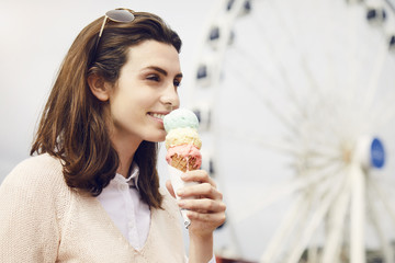 Brunette woman with ice cream, outdoors