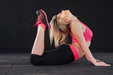 Gorgeous blonde in the audience doing various stretching fitness