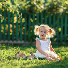 Portrait of happy pretty girl with rabbit