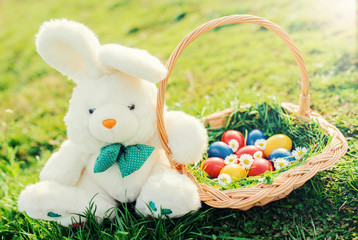 Easter holiday. Colorful Easter eggs and bunny in the grass