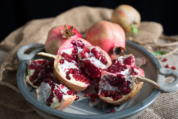 Pomegranate fruit arranged on wooden table top