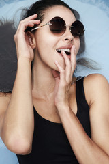 Young woman relaxing in shades in water
