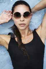Cool swimsuit girl in shades, portrait