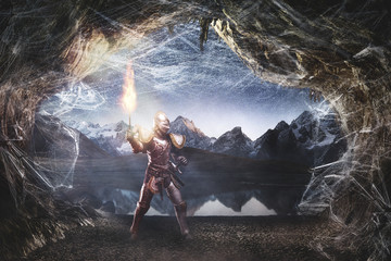 Knight exploring a cave full of spider webs