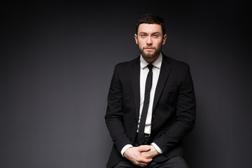 Elegant man close up portrait against dark background.