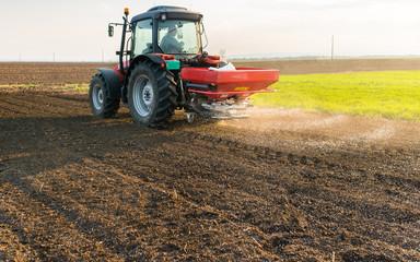 Tractor spreading artificial fertilizers