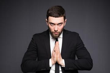 elegant business man with pray gesture