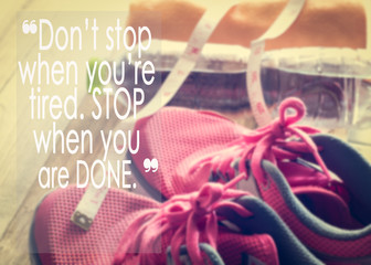 Inspirational quote on sneakers, towel, water and tape measure background