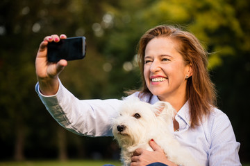 Selfie - senior woman and dog