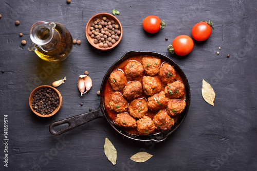 Meatballs with tomato sauce and green herbs stock photo for Voltan tortellini