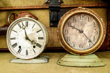 Two vintage weathered alarm clocks