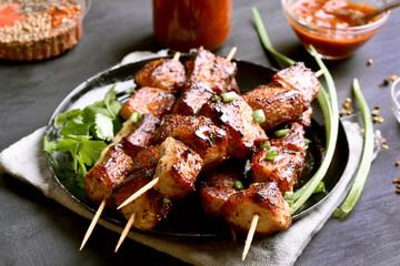 Grilled pork kebabs on plate