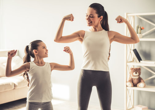 Mom and daughter working out