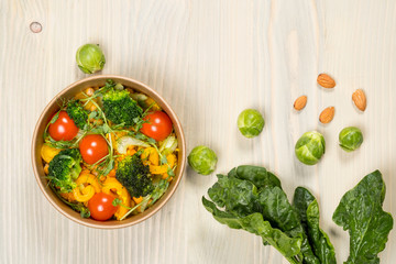 Cooking diet detox salad for vegetarian, vegan food, vitamin snack and health life. Top horizontal view on light wood background and copy space. White overhead flat food photo.