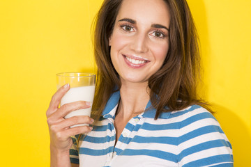 young woman drink milk