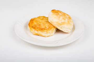 Two Southern Biscuits on a White Plate