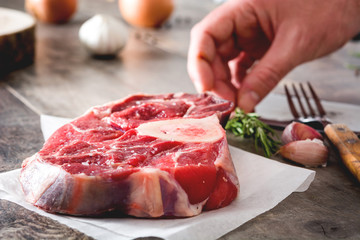 Preparing meat plate on wooden background
