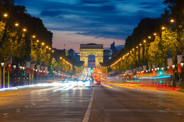 Night view of Paris traffic in Champs-Elysees street and the Arc de Triomphe in Paris, France.