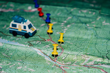 Toy Bus is on a topographic map, the route indicated by the pushpin