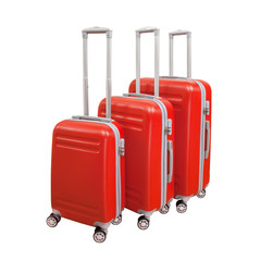 Three suitcases isolated on white background. Polycarbonate suitcases isolated on white. Red suitcases.