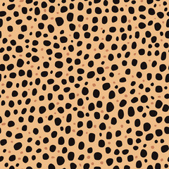 Seamless pattern. Imitation print of skin of cheetah. Black and brown spots on brown background.