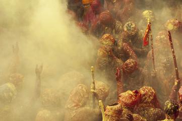 People celebrating Holi festival in Mathura