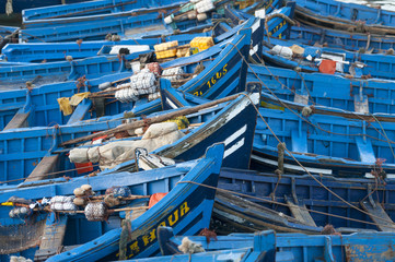 Port, Essaouira, Morocco. Typical blue portoguese boats moored at the port.