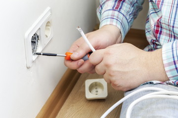 Man trying to fix electrical sockets