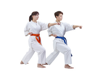 Women in karategi are training punch arm on a white background