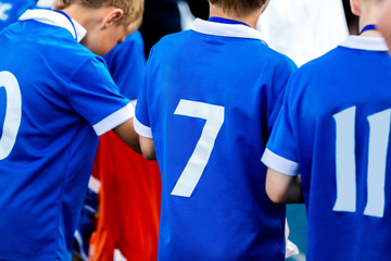 Sport t-shirt. Young sport player closeup on sport uniform number. Sport team background.