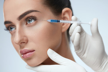 Woman Face Receiving Beauty Injections In Skin