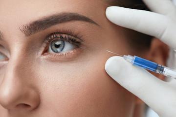 Closeup oF Beautiful Woman Face Getting Skin Lift Injection