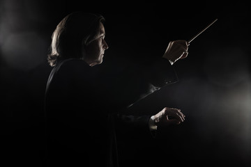 Photo sur Aluminium Musique Orchestra conductor music conducting with baton Maestro