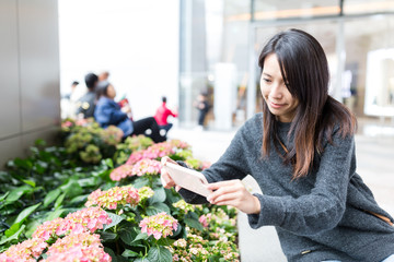 Woman taking photo on flower