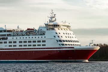 Red cruise liner's bow. Passenger ferry underway