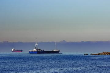 Blue cargo ship leaving Riga and entering Baltic sea