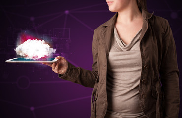 Woman holding tablet with cloud graphic