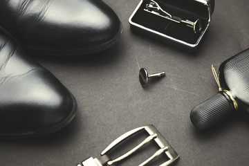man shoes, belts and perfume