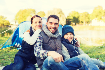 happy family with tent at camp site