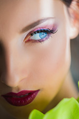 Half of beautiful face of woman with makeup and glance aside