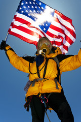 A mountaineer using oxygen flying the American Flag