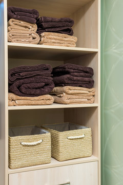 Folded towels in the closet