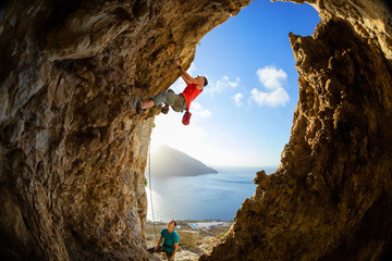 Rock climbers in cave
