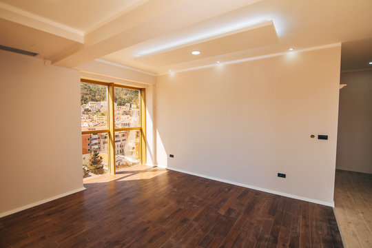 An empty apartment with no furniture. The apartment is renovated. Apartment for rent.