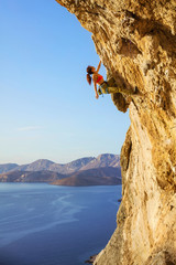 Female rock climber on challenging route